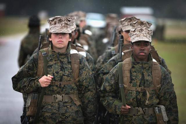 Female Marine recruits prepare to fire on the rifle range in 2013 during boot camp at MCRD Parris Island, S.C. The Marine Corps plans to establish an experimental force consisting of at least 25 percent women to determine how females perform in ground combat jobs. (Scott Olson / Getty Images)